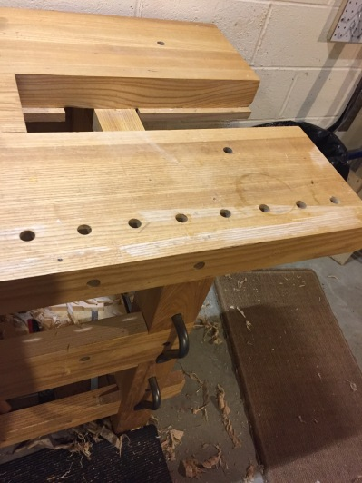 The workbench tray is removed exposing the split top nature of the bench
